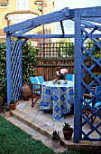 SUBURBAN PATIO WITH BLUE  ARBOUR