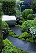 UP ON THE ROOF,  DES. JENNIFER HIRSCH. GREEN ROOF GARDEN WITH STEEL WATER BUTT & POLISHED STONE PAVING. INC. BOX (BUXUS SEMPERVIRENS),  SCLERANTHUS & AEONIUM