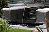 STEEL AND GLASS WATERFALL. FLEMINGS NURSERIES AUSTRALIAN GARDEN,  DES. DEAN HERALD