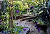 RAILWAY SLEEPER STEPS & EDGING WITH  PHORMIUM AND VERBENA BONARIENSIS