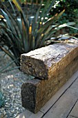 RAILWAY SLEEPER BENCH IN DROUGHT TOLERANT GARDEN.