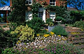 FRONT GARDEN,  HERBACEOUS BORDERS WITH SEATING AREA.