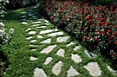 Paved pathway in lawn in Park of the Tete dOr Rosery, Lyon, France