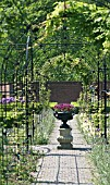 ORNAMENTAL IRON ARCHWAY WITH URN
