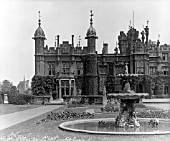 THE SOUTH-WEST FRONT OF KNEBWORTH HOUSE.  IN 1813-16 THE HOUSE WAS REDUCED TO ITS WEST WING, WHICH WAS REMODELLED IN A TUDOR GOTHIC STYLE BY JOHN BIAGIO REBECCA FOR MRS BULWER-LYTTON, AND THEN WAS TRANSFORMED IN 1843-45 BY HENRY EDWARD KENDALL, JR. INTO THE PRESENT TUDOR GOTHIC STRUCTURE.