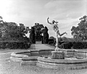 A WING FOOTED MERCURY FLYING ABOVE A POOL OF WATER LILLIES, AT MADRESFIELD COURT.