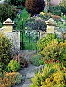 A WROUGHT IRON GATE IN THE GARDEN AT NESS HALL