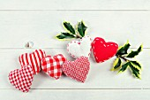 RED AND WHITE FABRIC HEARTS WITH HOLLY