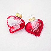 RED HEART BAUBLES IN THE SNOW