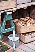 POTS AND WOODEN CRATES IN A POTTING SHED