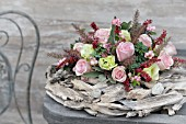 FLOWER ARRANGEMENT WITH PINK ROSES ON A WREATH OF DRIFTWOOD