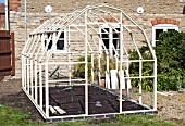 GREENHOUSE CONSTRUCTION AT WAKEFIELDS GARDEN, MAIN STRUCTURE PART COMPLETED, NOT GLAZED.