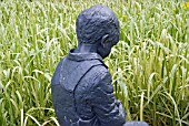 SCULPTURE OF CHILD AT HARLOW CARR GARDEN