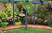 BLUE PERGOLA IN A SMALL GARDEN