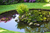 POND WITH ROCKERY AT TATTON HALL, CHESHIRE, UK