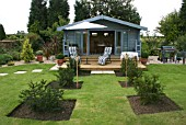 PATIO BY SUMMER HOUSE,  NEWLY PLANTED YEW PLANTS (KEXBY HOUSE,  LINCOLN)