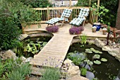 SUN LOUNGERS; DECKING AND ORNAMENTAL POND; WILSTON GARDENS NR GRANTHAM.