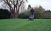 CUTTING GRASS WITH ROTARY LAWNMOWER