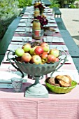 OUTDOOR LIVING; LAID TABLE WITH FRUIT BOWL OF APPLES