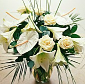 WHITE FLOWERS AND GREEN FOLIAGE FLOWER ARRANGEMENT