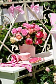 BOUQUET OF ROSES IN A PINK BUCKET ON THE BALCONY -