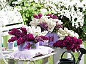 LILAC BLOSSOMS IN METAL POTS