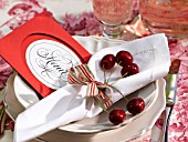 NAPKINS  CHERRIES AND A MENU CARD