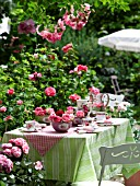 GARDEN TABLE EMBELLISHED WITH ROSES