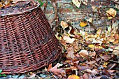BASKET WITH LEAVES AS A WINTER NEST FOR HEDGEHOGS