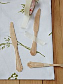 WOODEN CUTLERY PAINTED GREEN, BOTANICAL TABLE PROJECT TAPED DOWN READY FOR PAINTING