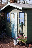GARDEN SHED WITH TOOLS OUTSIDE