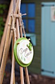 BAMBOO SUPPORTS WITH DREAM GARDEN SIGN