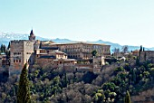 THE ALHAMBRA PALACES VIEW FROM THE ALBAICIN GRANADA,  SPAIN. THE COMARES PALACE  AND THE PALACE OF CHARLES V. SIERRE NEVAVDA MOUNTAINS.