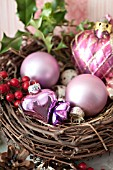 ILEX IN BIRD NEST WITH HEART SHAPED GLASS ORNAMENTS