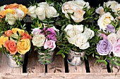BOUQUETS OF ROSES IN ZINC CONTAINERS