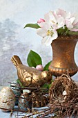 STILL LIFE WITH APPLE BLOSSOMS, GOLD BIRD, NEST AND CERAMIC EGGS