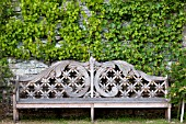 WOODEN BENCH IN FORMAL FRENCH GARDEN