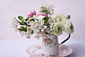 MALUS X EVERESTE  ROSA  RANUNCULUS ASIATICUS IN BOUQUET  IN A VINTAGE PITCHER
