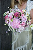BOUQUET OF PINK PEONIES, GARDEN ROSES, RANUNCULUS AND SCABIOSA WITH GRASSES AND WILDFLOWERS