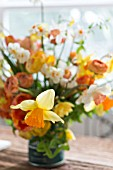 NARCISSUS, TULIPA, RANUNCULUS IN SPRING BOUQUET IN VINTAGE COFFEE TIN