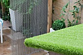 THE DRAWING ROOM GARDEN  URBAN LONDON GARDEN  ASTRO-TURF USED ON SHED ROOF CHAIN SCREEN TO THE REAR.  DESIGNED BY: EARTH DESIGNS.
