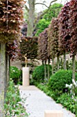 THE LAURENT PERRIER BICENTENARY GARDEN, DESIGNER ARNE MAYNARD, RHS CHELSEA FLOWER SHOW 2012.  FOCAL POINT PATH WITH PLEACHED FAGUS SYLVATICA PURPUREA - COPPER BEECH