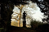 SILHOUETTE OF CLASSICAL STATUE OF YOUNG MAN AT ROUSHAM, OXFORDSHIRE