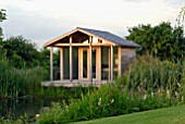 WOODEN SUMMERHOUSE BY POND