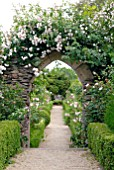 GOTHIC ARCH WITH RAMBLING ROSE AT HANHAM COURT