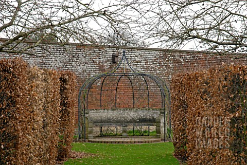 METAL_ARBOUR_AND_STONE_SEAT_AT_OZLEWORTH_PARK_GLOUCESTERSHIRE