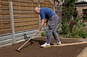 RAKING SOIL TO FINE TILTH PRIOR TO PLANTING
