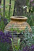 RUSTIC POT SURROUNDED BY DROUGHT RESISTANT PLANTS
