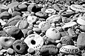 DECORATIVE STONES WITH MESSAGES IN BLACK AND WHITE