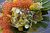 PROTEAS AND ORCHIDS USED IN MODERN BRIDAL BOUQUET